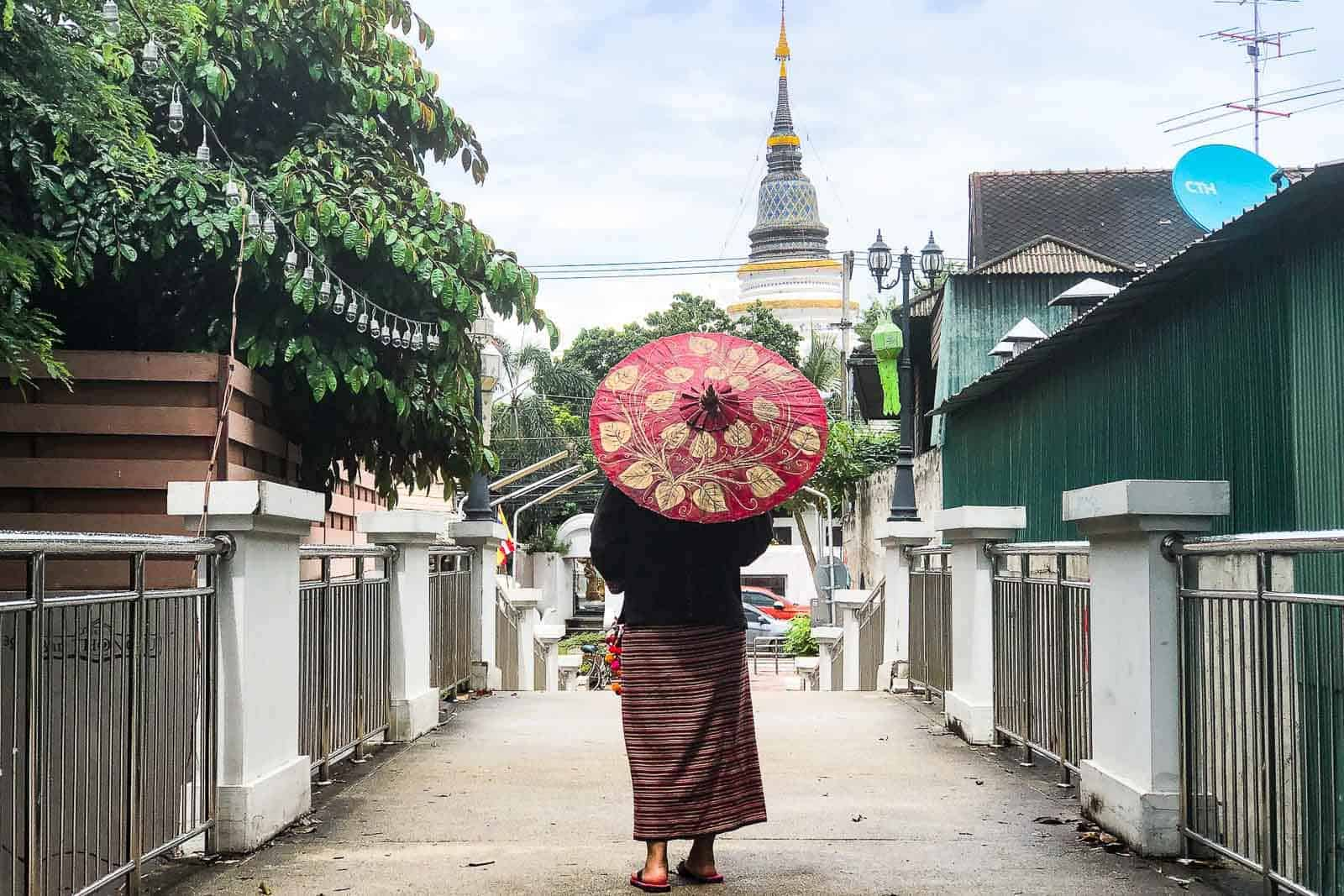 Lady Holding The Red Paper Umbrella Walking In On The Bridge In Chiang Mai
